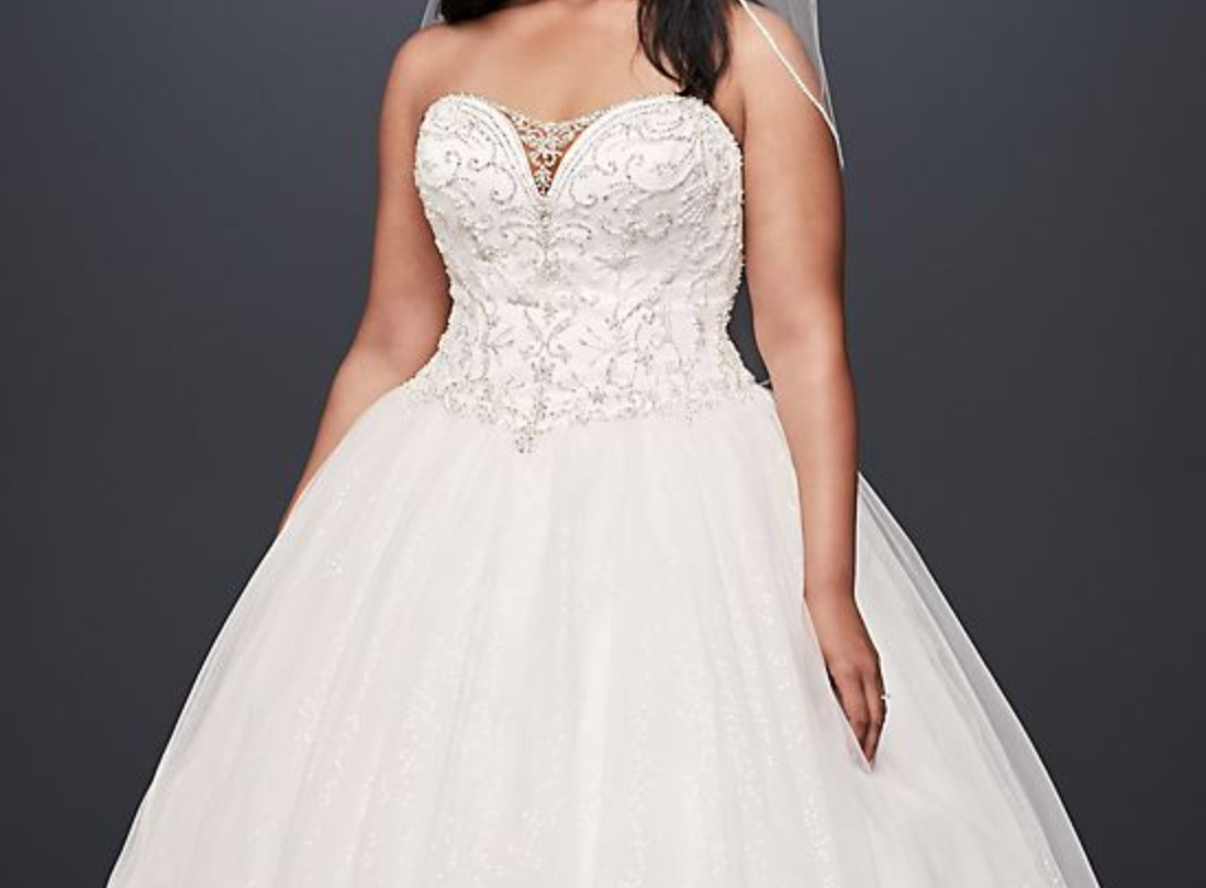 A strapless wedding gown with a beaded top and poofy skirt