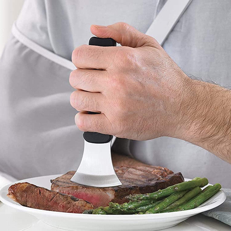 Model using a vertical black gripper on a curved blade cutting steak