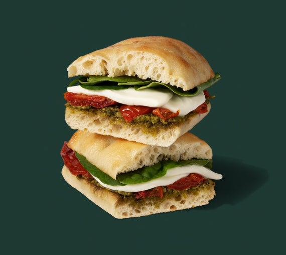 A tomato and mozzarella sandwich with pesto