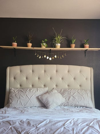 the moon phase garland over a reviewer's bed