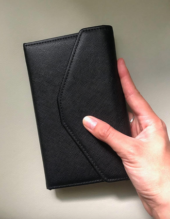 reviewer holding black wallet