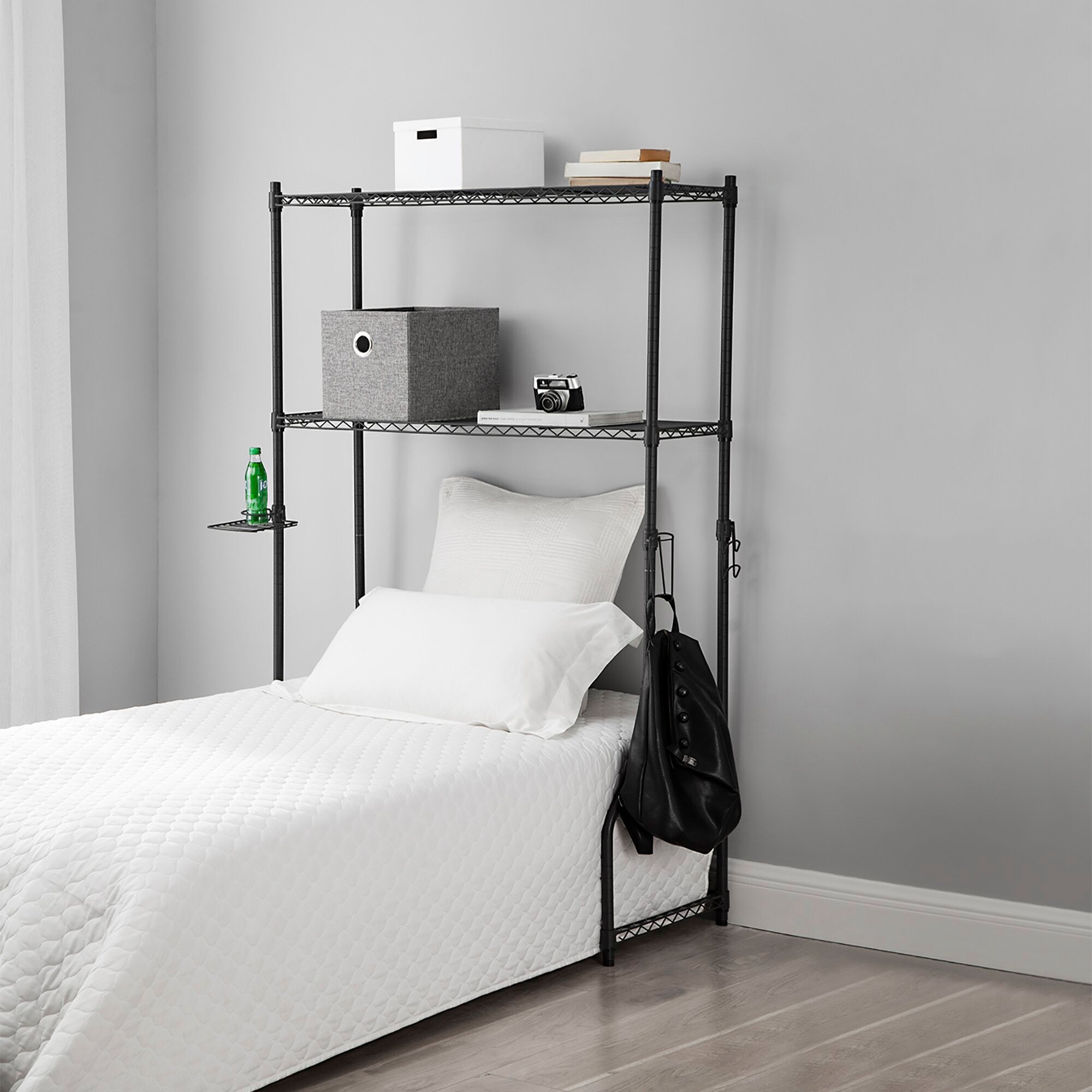 gray over the bed storage shelf with bins on it