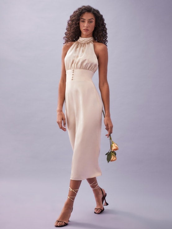 A silk dress with a halter top and buttons down the middle