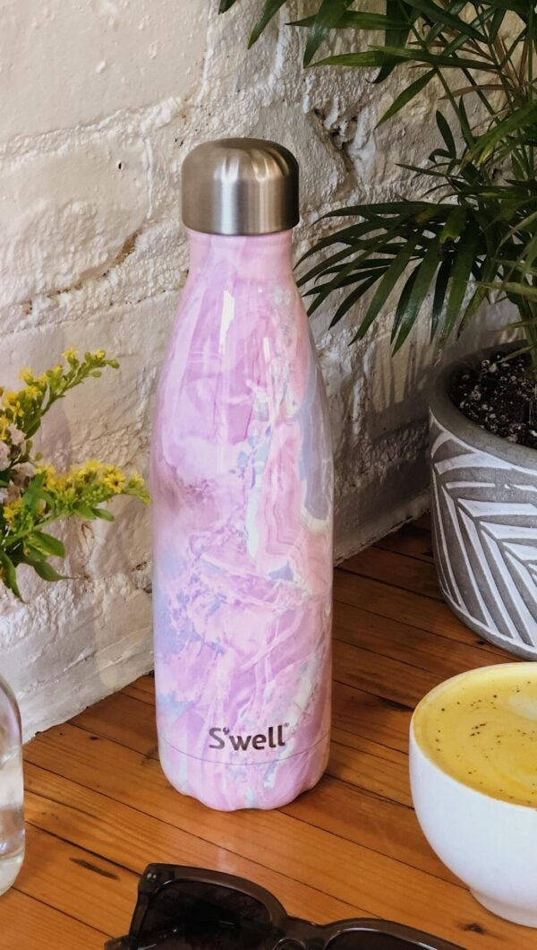 the water bottle in a pink and purple geode print