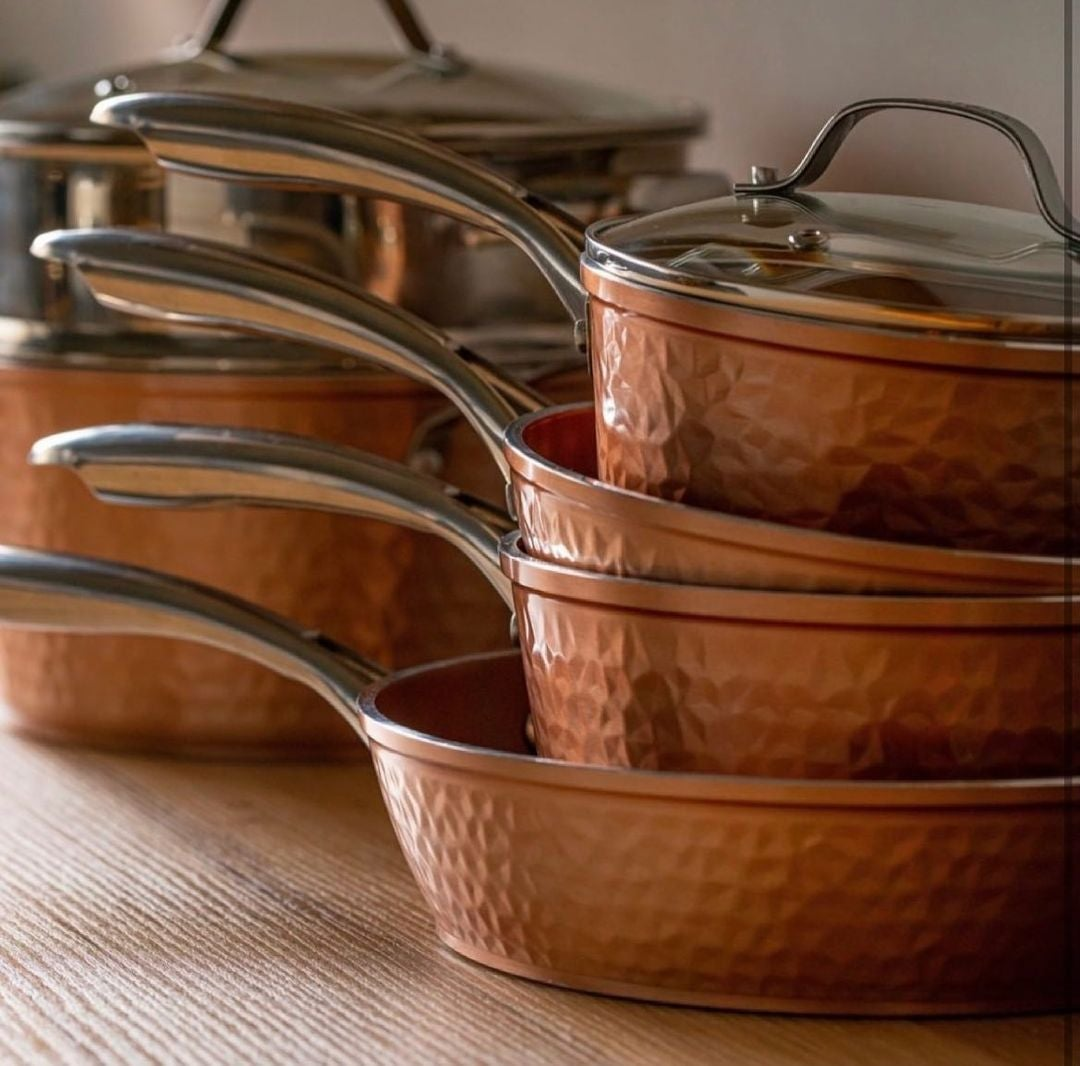 the five-piece hammered copper pan set