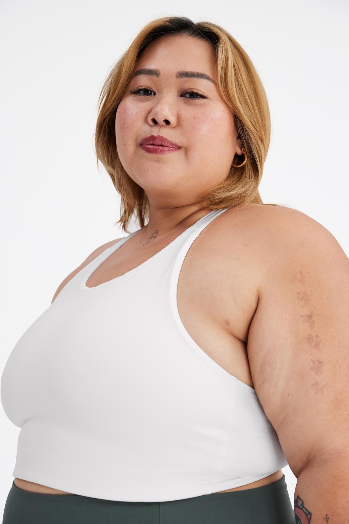 model wearing white sports bra