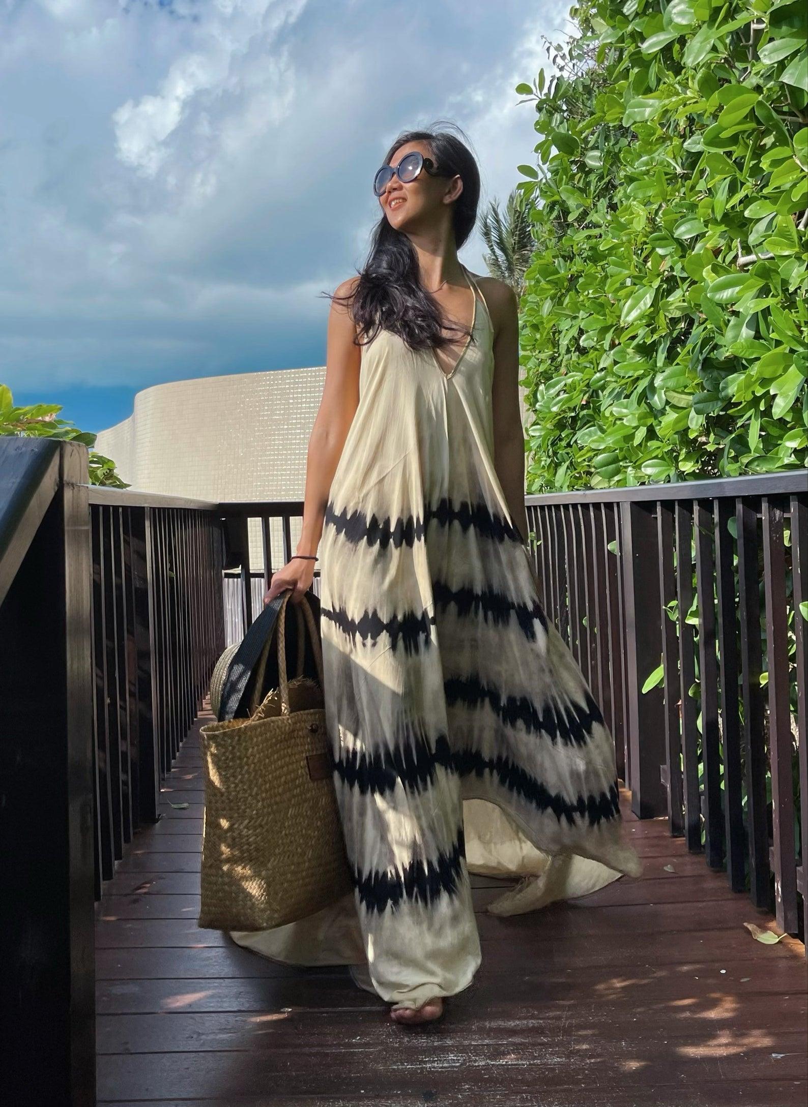 model in black-and-white tie-dye maxi dress