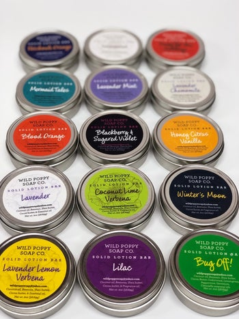 tins of solid lotion in different scents