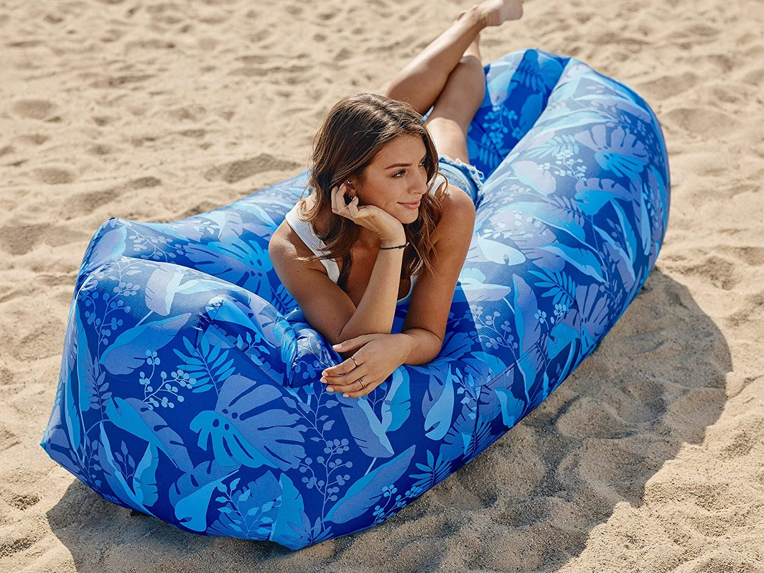 model on an inflated long lounger
