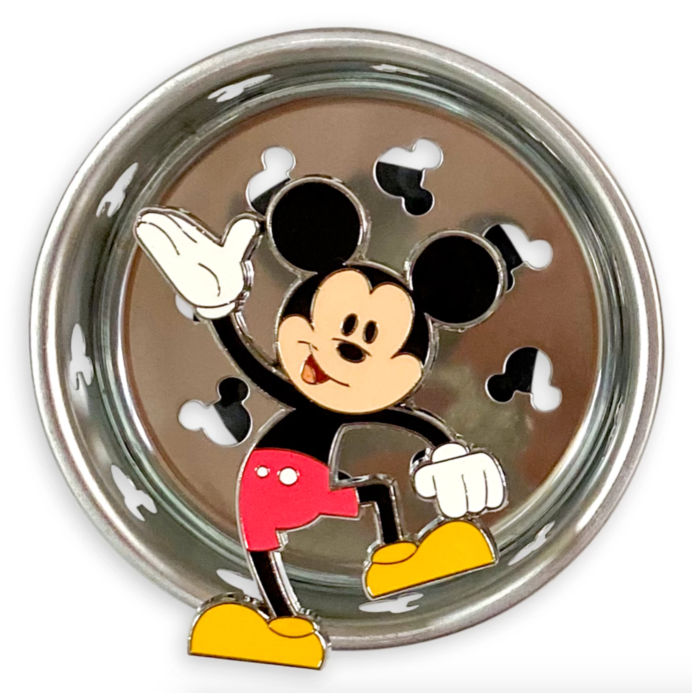 a silver drain stop with mickey-shaped holes to drain out of as well as an animated mickey in the middle