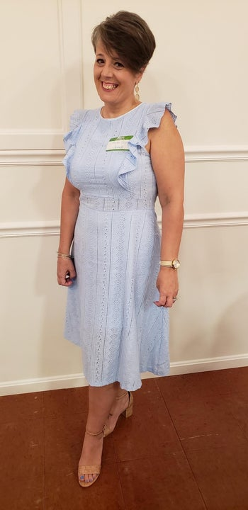 reviewer wearing the light blue version