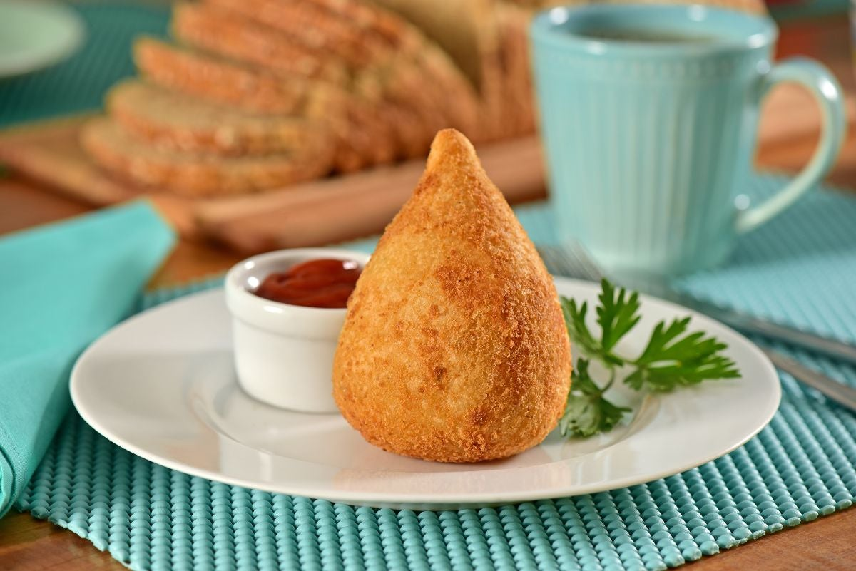 A teardrop-shaped fried dish