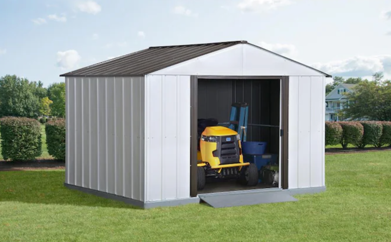 storage shed with lawnmower in it