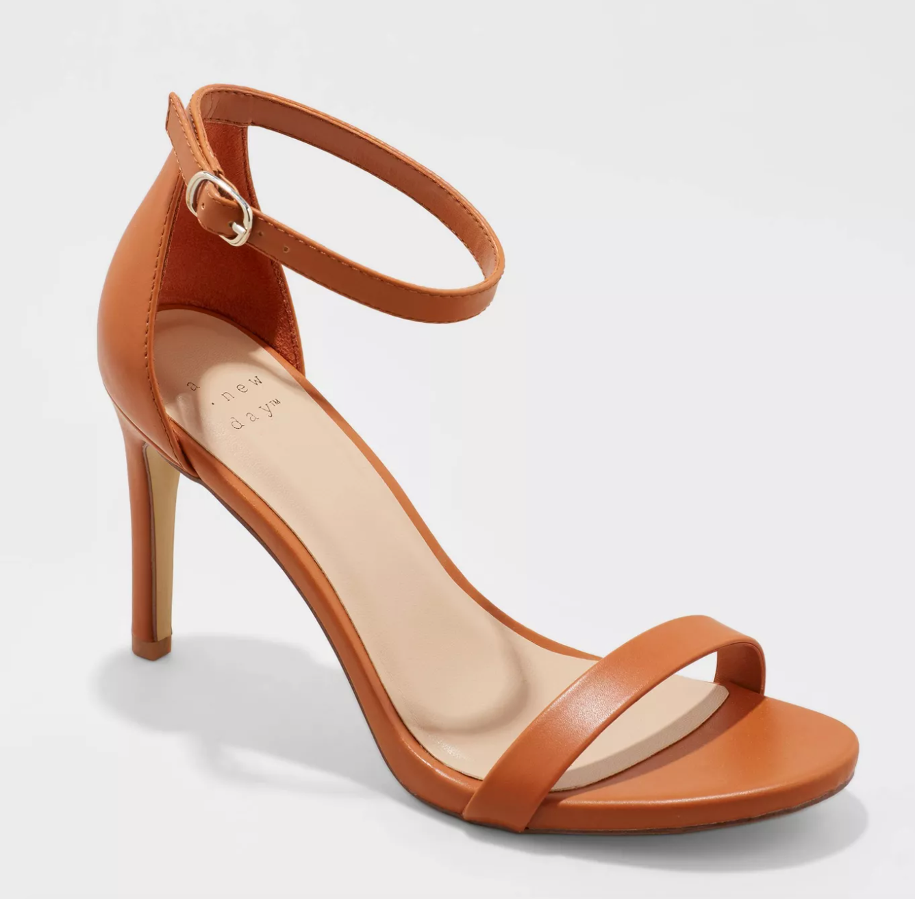 a brown shoe with a high thin heel and an ankle strap
