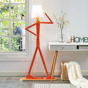 the person-like shaped floor lamp with a lamp shade where the head would be