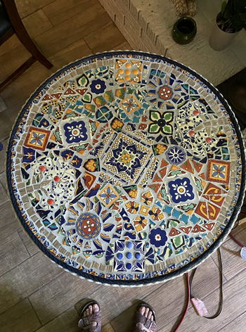 reviewer's table re-created with a mosaic tile design