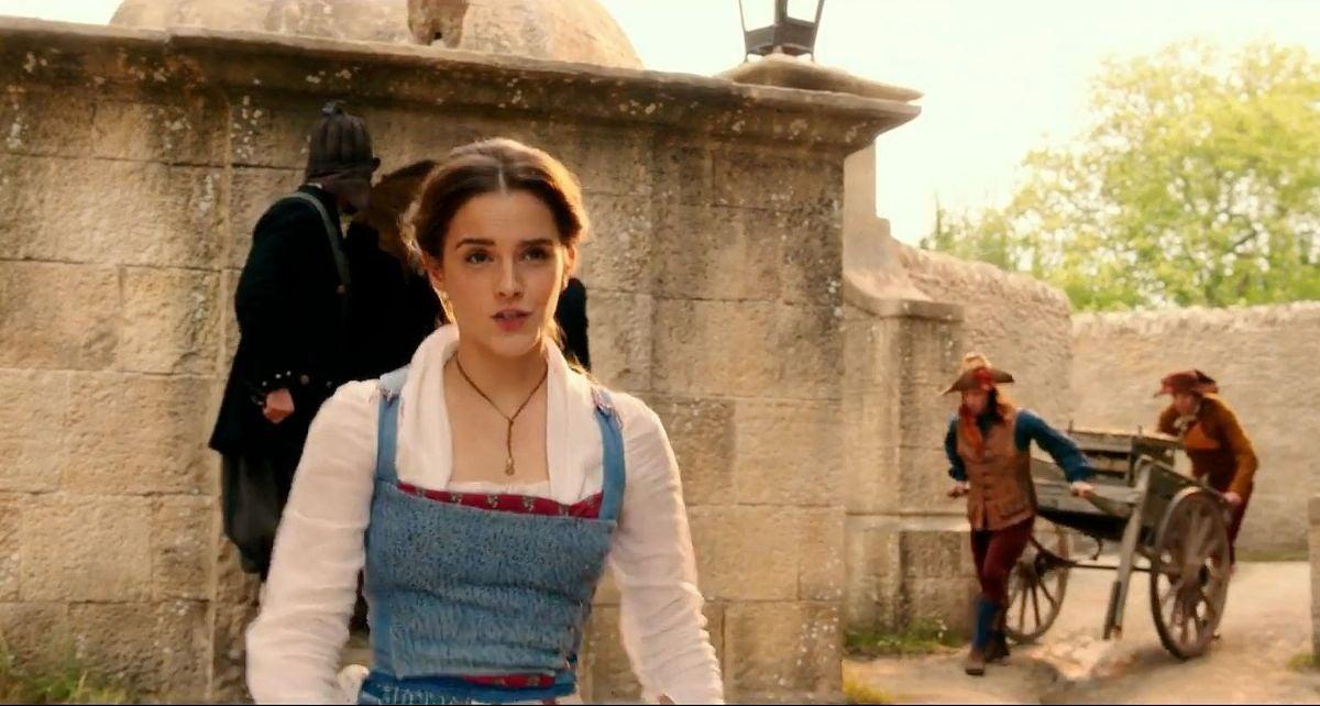 """Emma Watson sings """"Belle"""" as Belle in """"Beauty and the Beast"""" as she walks down the cobblestone street"""