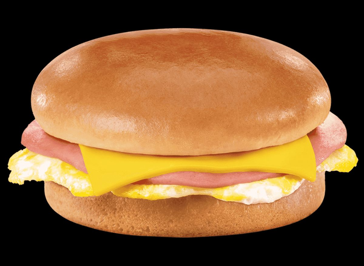 A breakfast sandwich with egg, cheese, and ham