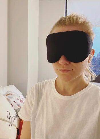 BuzzFeed editor wearing black eye mask