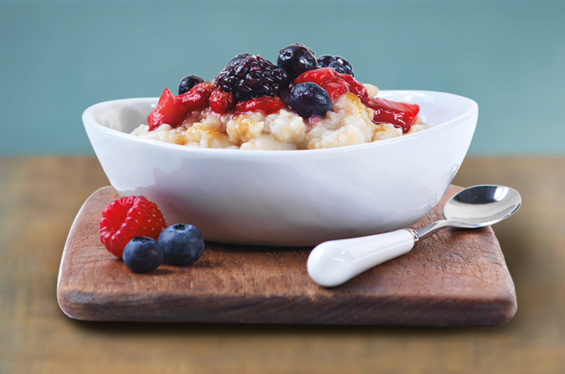 A bowl of oatmeal topped with berries