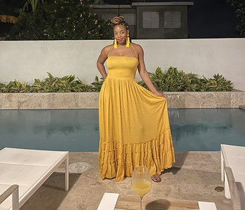 reviewer wearing the mustard colored dress