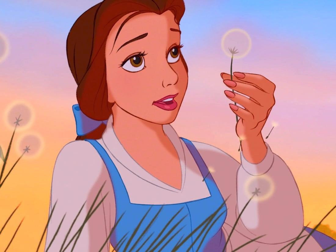 Belle inspects onto a dandelion puff
