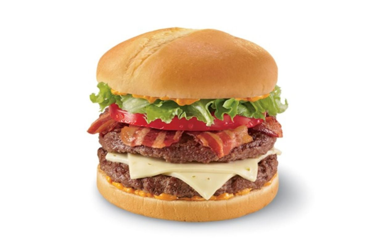 A double cheeseburger with pepper jack cheese, spicy sauce, lettuce, tomato, and bacon