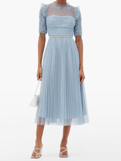 A dress with a ruffly neckline and ruched, 3/4 length sleeves