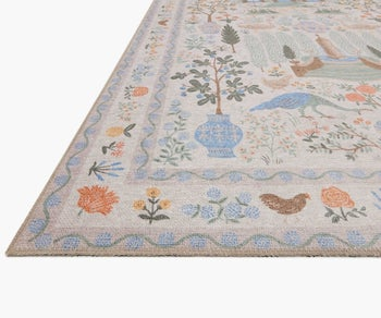zoomed in view showing the loomed animal and floral print