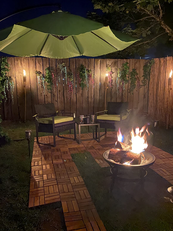 different reviewer backyard with them set up around fire pit
