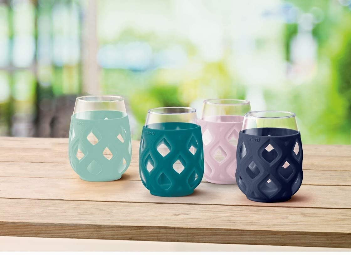 four glasses with mint, teal, lavender, and navy silicone sleeves