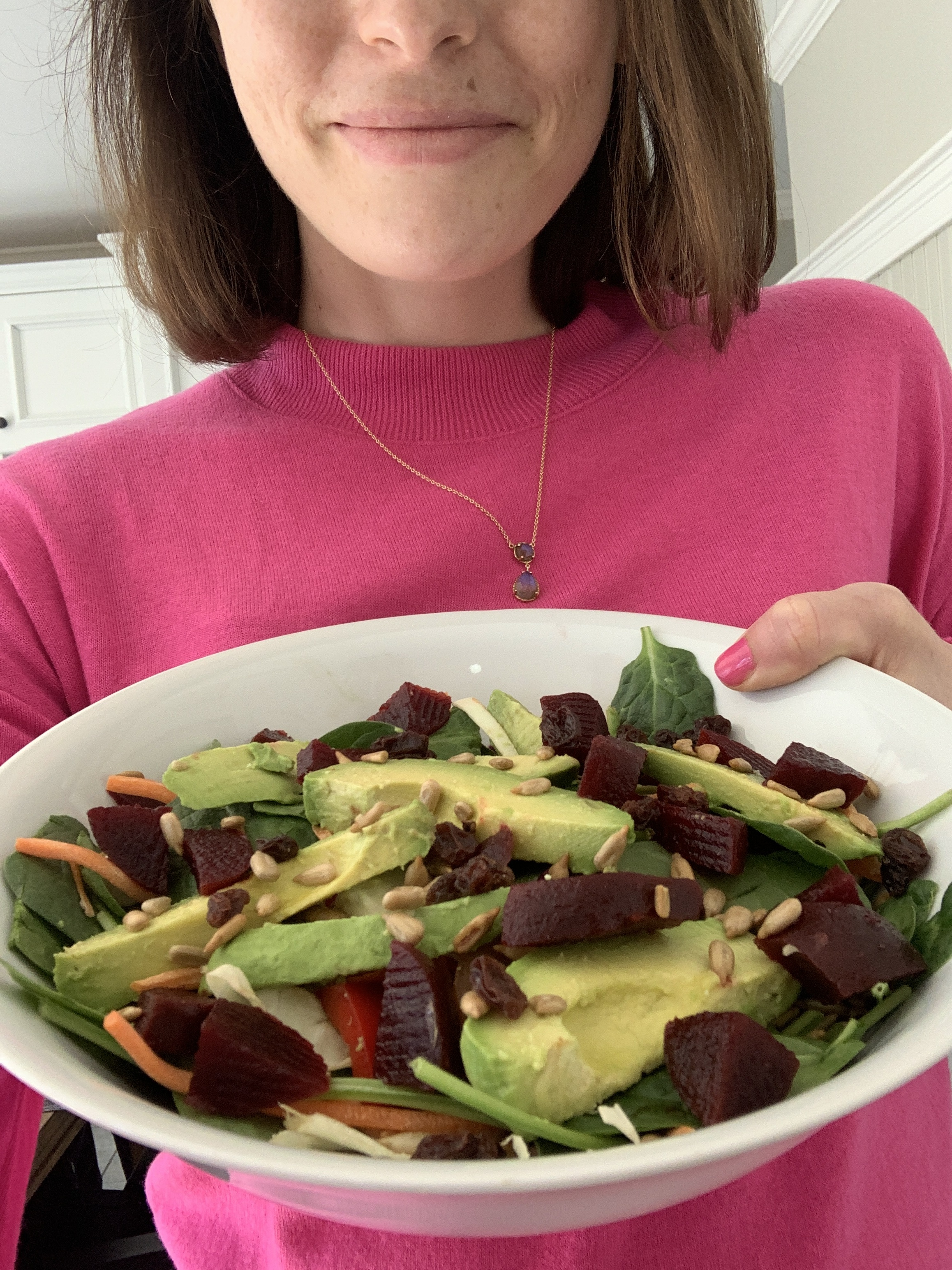 woman holding homemade salad vertically