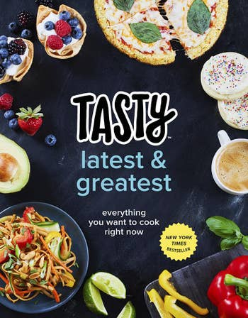 cookbook cover for Tasty Latest & Greates with a tabletop full of assorted food, desserts and coffee