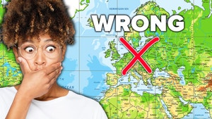 An African American woman is reacting to a map projection of the world that has red
