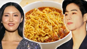 hwasa and mark tuan in front of a delicious bowl of ramen