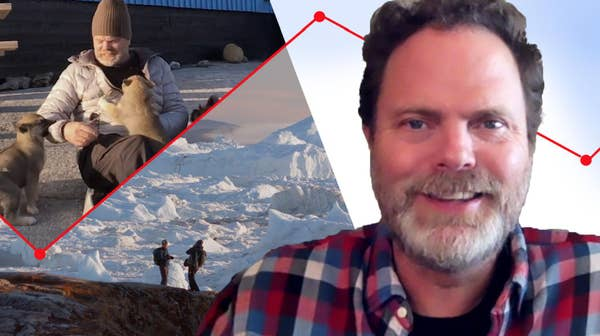 Rainn Wilson smiles, gets bitten by sled dogs, and looks out onto the tundra.