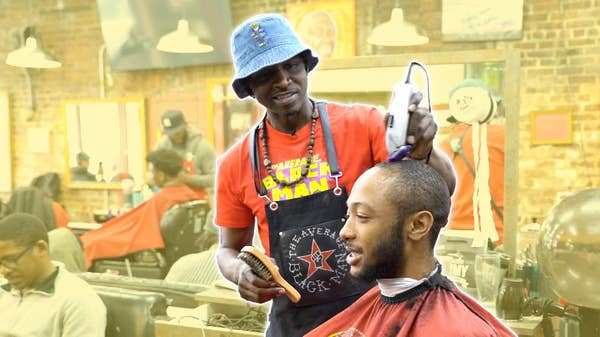 Barber shaves a man's face