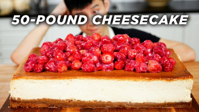 Alvin looks at huge cheesecake with strawberries on top.