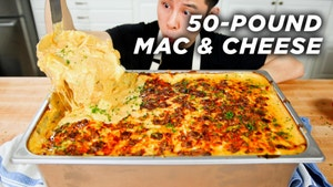 Alvin scoops a huge macaroni and cheese dish from a pan.
