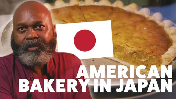 """Man with a sweet potato pie and Japan flag with the text """"American bakery in Japan"""""""