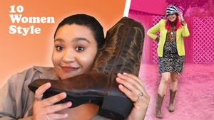 Jazzmyne holding up cowboy boot.