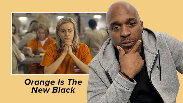 "A man looks quizzically at a scene from ""Orange Is The New Black"""