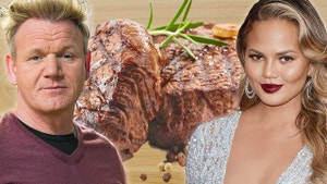 Chef Ramsey and Chrissy in front of steak.