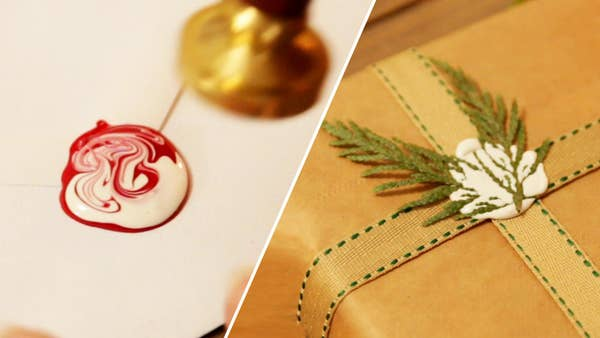 Two wax seals. One is white with evergreen branches and the other is marbled red and white.