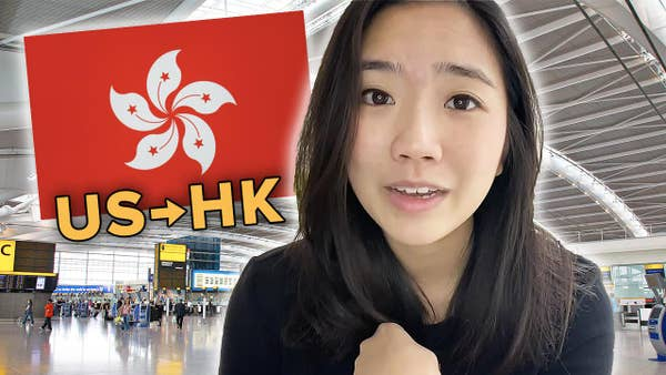 Helen with a Hong Kong flag, in front of airport photo.