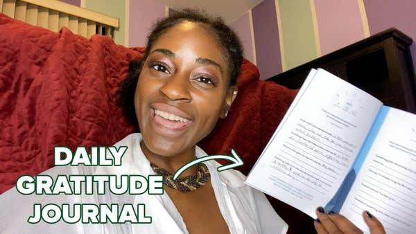 Vivian holding her gratitude journal.