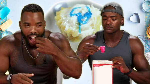 Two body builders and a tiny cake.