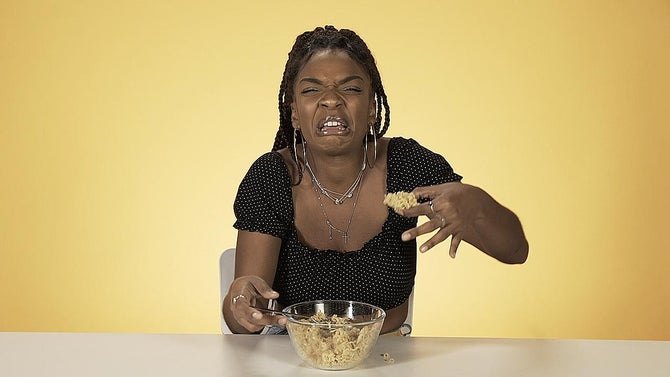 Cheyenne looks disgusted holding a clump of ramen noodles