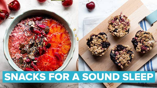 A vibrant bowl of pink porridge topped with bright slices of blood orange and sprinkled with seeds! 4 oaty cupcakes sit upon a small chopping board, bursting with pops of dark red cherries! A golden loaf of bread sits on top of a wooden chopping board.