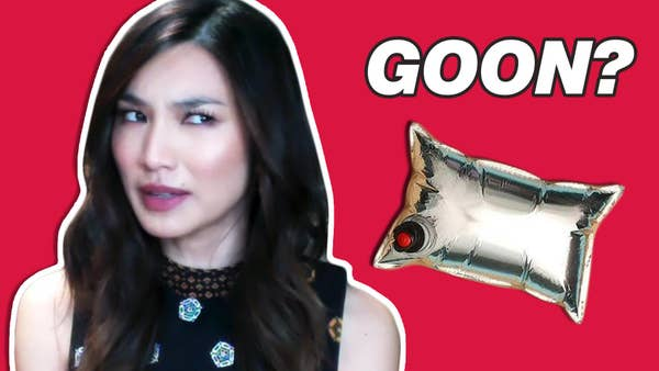 """Gemma Chan with a confused expression on her face; the word """"Goon"""" is written along with a picture of boxed wine"""